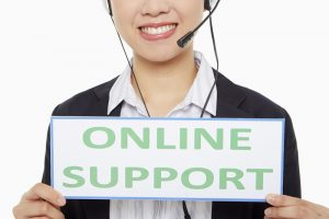 """Businesswoman holding up an """"Online Support"""" sign"""